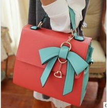 Unique dimensional bow handbag