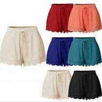 Fashion Solid Color Elastic Waist Lace Spliced Hem Shorts